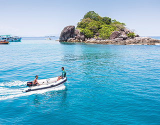 holiday in thailand | recreation on blue waters near harleymoon hideaway resort